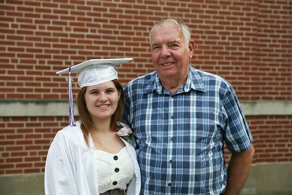 Stephen M. Wallace/contributor-Jennifer Boetcher, Roy Hart '14, and her proud grandpa Tony Barniak .