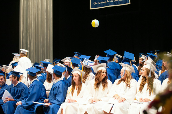 140628 JOED VIERA/STAFF PHOTOGRAPHER-Buffalo, NY-Newfane graduates entertain themselves with a beach ball as they wait for thier peers to walk the stage during thier graduation ceremony at UB's Center for the Arts. June 28, 2014