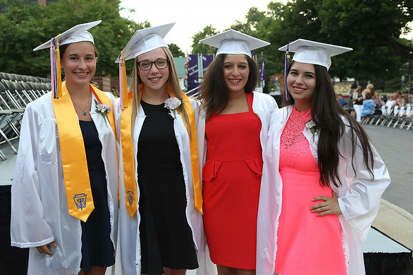 Stephen M. Wallace/contributor-Roy Hart class of 2014 classmates Melissa Lakrzewski, left, Alyssa Dodge, Alejaner T. Suarez and Shelby Smith are all smiles before the graduation ceremony Saturday evening at the high school.