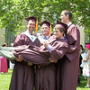 Julie Obermiller/contributor-Hayden Gooding, Ben Kaiser and Bryce Moeller give fellow Barker High School graduate Cody Baronich a boost after their 2014 commencement exercises Saturday morning.