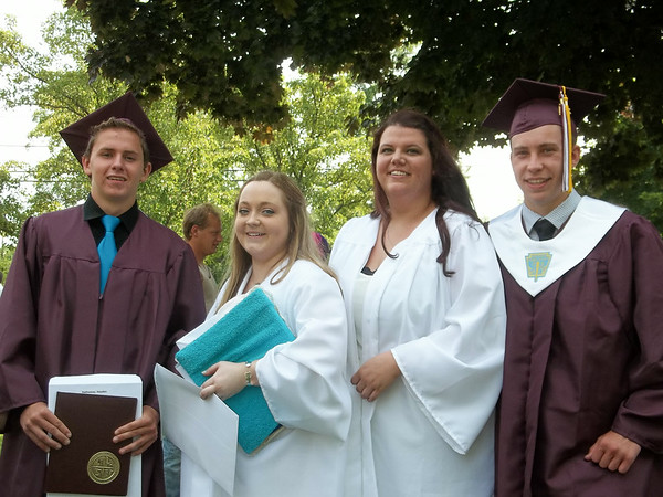 Julie Obermiller/contributor-Barker High School graduates Hayden Hathaway, Leah Smith, Taylor Martineck and Nolan Bouchane are all smiles after commencement exercises Saturday morning at the school.