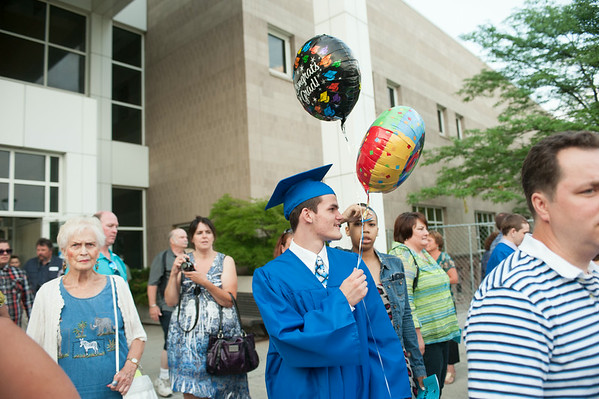 140628 JOED VIERA/STAFF PHOTOGRAPHER-Buffalo, NY-Newfane graduate Alex Barone walks with celebratory balloons outside of UB's Center for the Arts. June 28, 2014