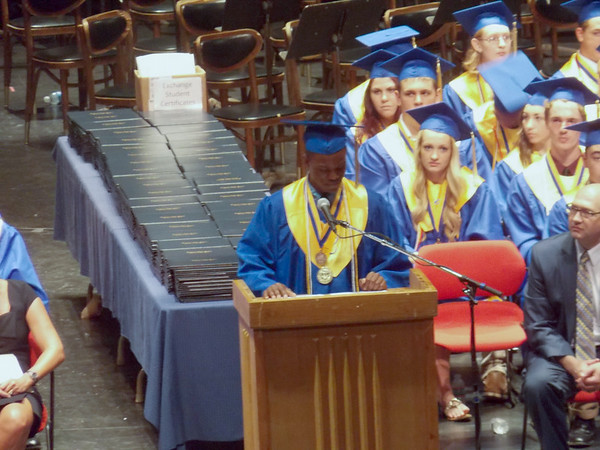 """Kaley Lynch/staff-Nse Obot, valedictorian of the Lockport High School class of 2014, gives the farewell speech, """"Adios,"""" to the class during commencement exercises Saturday afternoon at Artpark."""