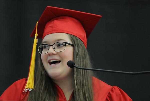 PAUL BILODEAU/Staff photo. Saltutatorian Kaitlin Copelas  delivering her speech  during Salem High School's graduation ceremony in the high school's field house.