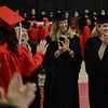 PAUL BILODEAU/Staff photo. teachers get their last look at the graduation class as they enter the gym during Salem High School's graduation ceremony in the high school's field house.