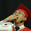 PAUL BILODEAU/Staff photo. Valedictorian William Phu enjoys a Munchkin as a visual to enjoy the small things in life during his speech at Salem High School's graduation ceremony in the high school's field house.