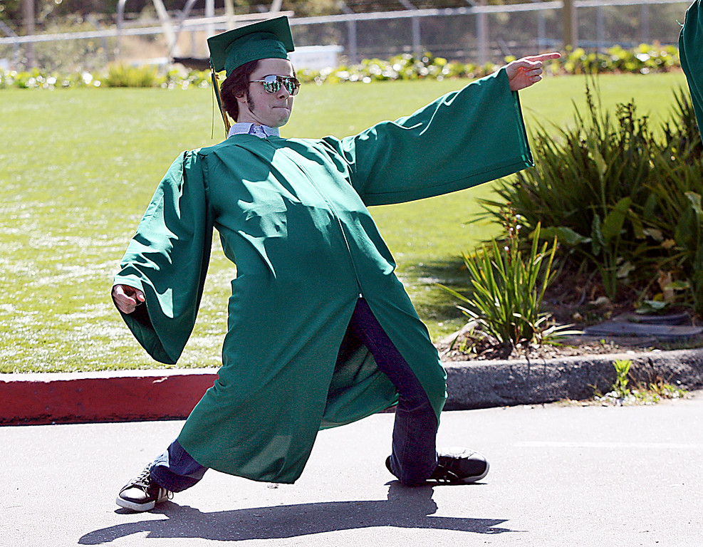 . Harbor High grad shows his \'stoke\' as he waits to march with his classmates Friday afternoon. (Dan Coyro -- Santa Cruz Sentinel)