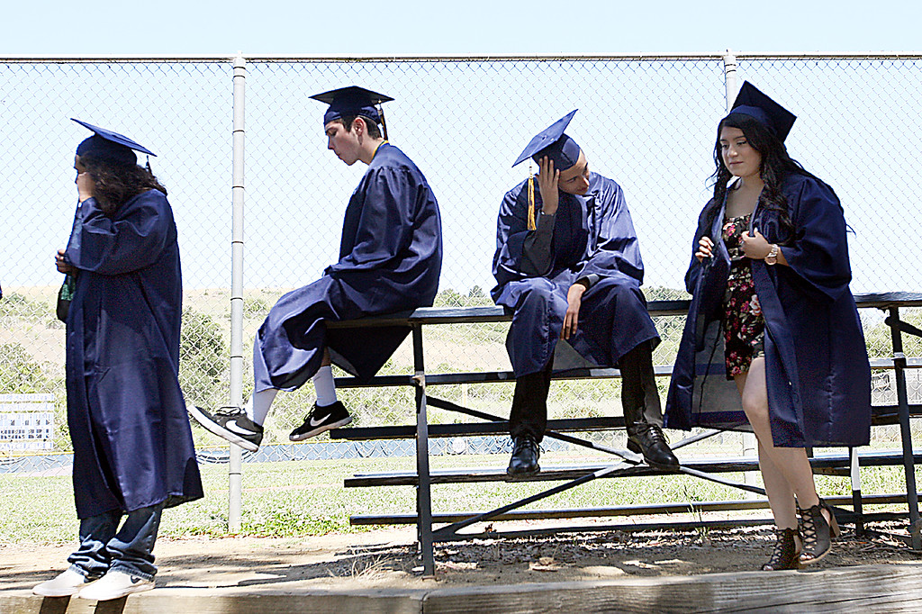 . Soquel High seniors wait near the baseball diamond before marching onto the football field for their graduation ceremony Friday morning. (Dan Coyro -- Santa Cruz Sentinel)