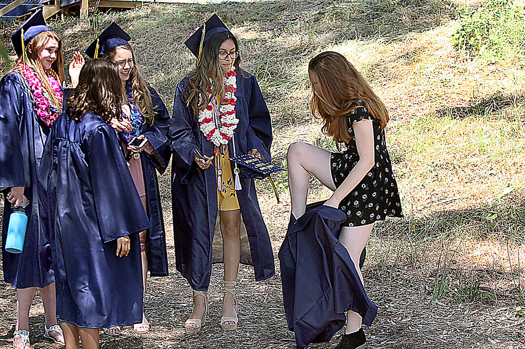 . Soquel High graduating classmates of Hanna Innis-Skinner are mildly entertained as they watch her climb into her gown Friday morning. (Dan Coyro -- Santa Cruz Sentinel)