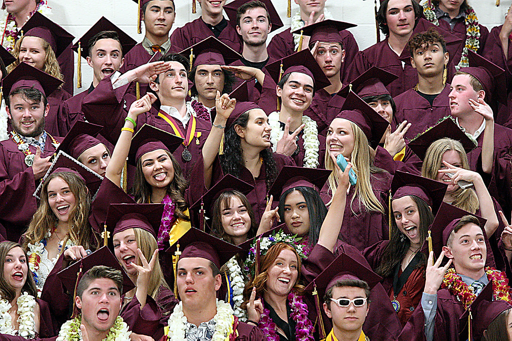 . After standing still for their class photo, Scotts Valley High graduating seniors are turned lose to make a face or gesture they want for the \'informal\' picture Wednesday afternoon. (Dan Coyro -- Santa Cruz Sentinel)