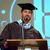 Debby High — For Montgomery Media<br /> Faith Christian Academy Headmaster Ryan Clymer presents awards during the 2015 graduation commencement.