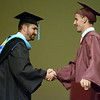 Debby High — For Montgomery Media<br /> Robert Cole Adams receives a handshake from Headmaster Ryan Clymer after receiving his diploma.