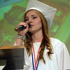 Debby High — For Montgomery Media<br /> Desiree Pringle sings during the graduation ceremony.