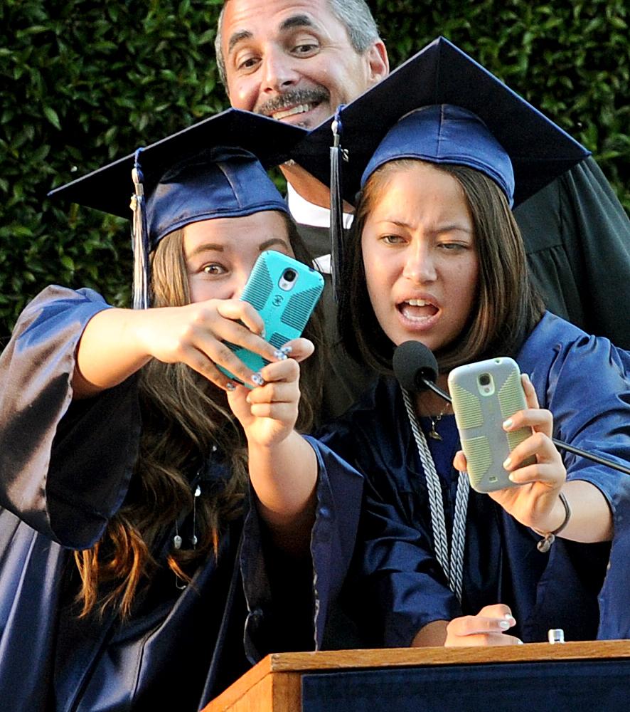 ". Erin and Rachel Natsume, senior class members take a \""selfie\"" before conducting Ceremonial \""Turning of the Tassel\"".Gabrielino High in San Gabriel School Class of 2014 graduation was held at Santa Anita Park in Arcadia Wednesday, June 4, 2014.Photo by Walt Mancini/Pasadena Star-News)"
