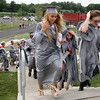 Upper Dublin seniors climb the stairs to the stadium where they will soon become graduates June 8, 2015.<br /> Bob Raines--Montgomery Media