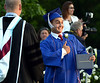 A new graduate gives the thumbs-up as he shows off his diploma from Springfield Township High School  June 10, 2015.<br /> Bob Raines--Montgomery Media