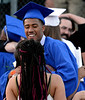 A new graduate meets his family after the Springfield Township High School graduation ceremony June 10, 2015.<br /> Bob Raines--Montgomery Media