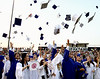 Graduates toss their hats in the air at the close of the Springfield Township High School commencement ceremony June 10, 2015.<br /> Bob Raines--Montgomery Media