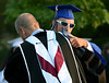 Springfield Township High School Principal Charles Rittenhouse gets a hug from a graduate June 10, 2015.<br /> Bob Raines--Montgomery Media