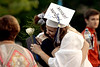 A former senior embraces a friend after the Springfield Township High School graduation ceremony June 10, 2015.<br /> Bob Raines--Montgomery Media