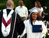 A new graduate looks both happy and relieved as she is congratulated by Springfield Township High School Principal Charles Rittenhouse June 10, 2015.<br /> Bob Raines--Montgomery Media