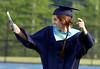 Bob Raines--Montgomery Media<br /> A senior dances her way into Trojan Stadium for Class of 2015 graduation ceremony June 11, 2015.