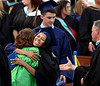 Principal Lyn Fields gets a big hug from a graduate as assistant principal James Cairnes greets the next new alumnus during the presentation of diplomas at the Wissahickon High School graduation June 11, 2015.<br /> Bob Raines--Montgomery Media