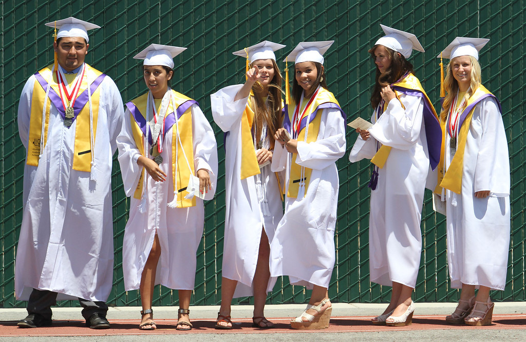 . Graduate candidates wait for the start of Lakewood High School\'s commencement Thursday at Veterans Memorial Stadium in Long Beach, CA Thursday, June 12, 2014. (Photo by Mark Dustin for the Press-Telegram)