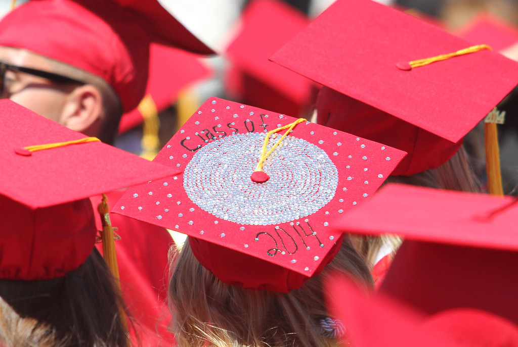 ". A graduate candidate decorated her cap with ""Class of 2014\"" decor for Lakewood High School\'s commencement Thursday at Veterans Memorial Stadium in Long Beach, CA Thursday, June 12, 2014. (Photo by Mark Dustin for the Press-Telegram)"