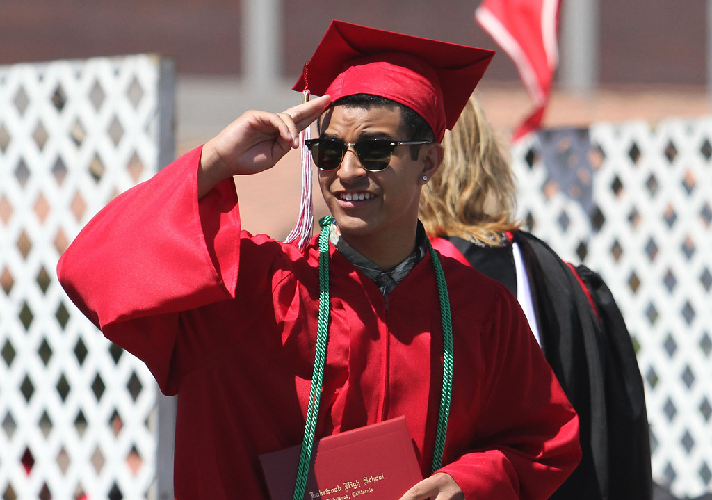 . Moe Modina salutes the crowd during Lakewood High School\'s commencement Thursday at Veterans Memorial Stadium in Long Beach, CA Thursday, June 12, 2014. (Photo by Mark Dustin for the Press-Telegram)