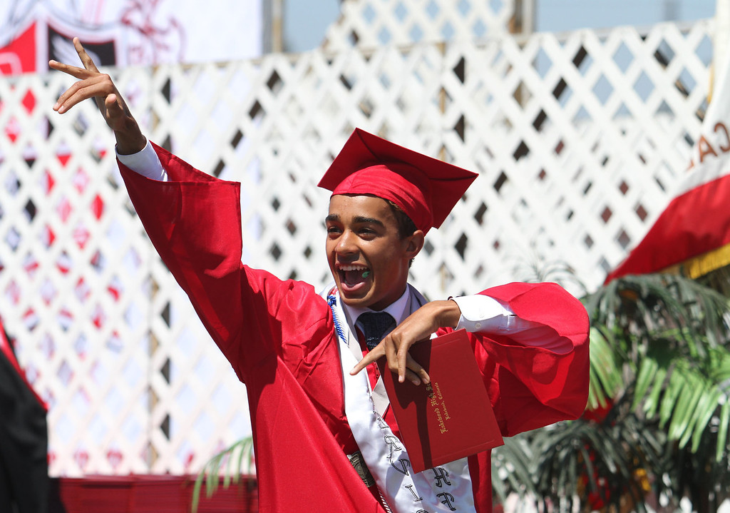 . Mackenzie Brown points to the crowd during Lakewood High School\'s commencement Thursday at Veterans Memorial Stadium in Long Beach, CA Thursday, June 12, 2014. (Photo by Mark Dustin for the Press-Telegram)