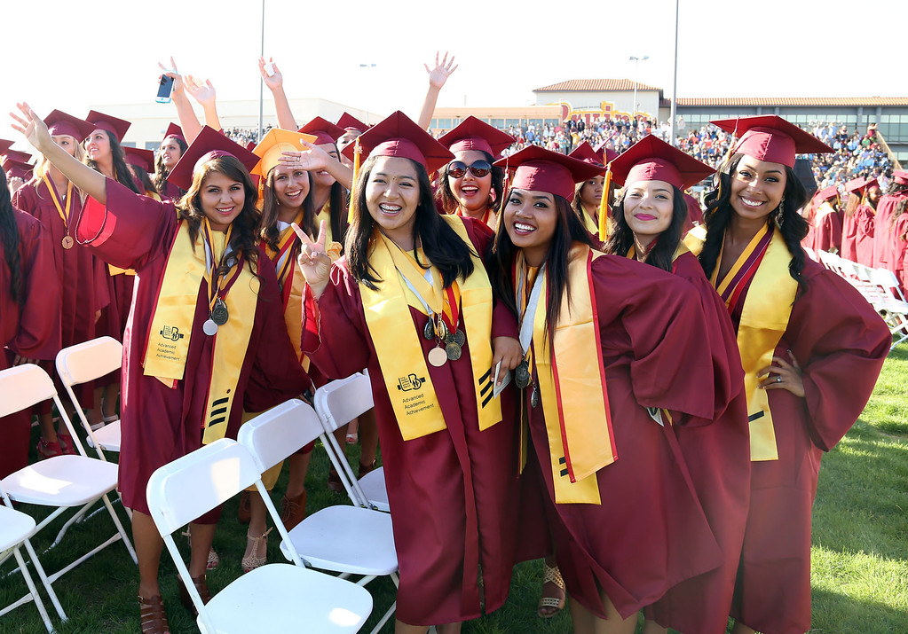 . Graduate candidates pose for a photo during Thursday evening\'s commencement at Stephens Field at Woodrow Wilson Classical High School in Long Beach, CA Thursday, June 12, 2014. (Photo by Mark Dustin for the Press-Telegram)