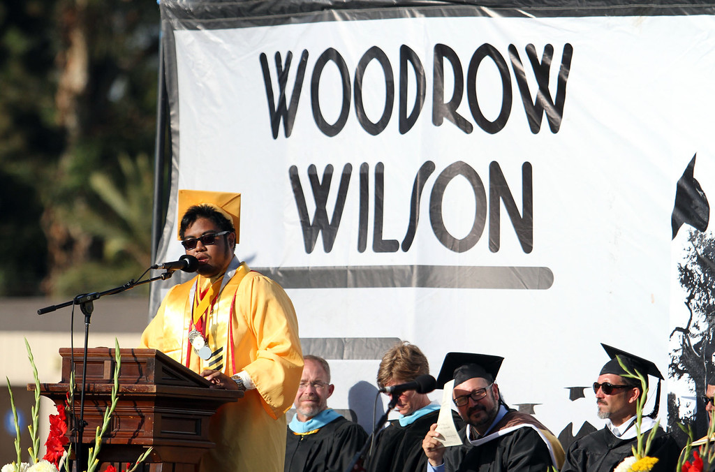 . Valedictorian Speaker Jon Frigillana, left, delivers his speach during Thursday evening\'s commencement at Stephens Field at Woodrow Wilson Classical High School in Long Beach, CA Thursday, June 12, 2014. (Photo by Mark Dustin for the Press-Telegram)