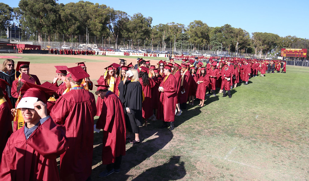 . Students line up in preparation for Thursday evening\'s commencement at Stephens Field at Woodrow Wilson Classical High School in Long Beach, CA Thursday, June 12, 2014. (Photo by Mark Dustin for the Press-Telegram)