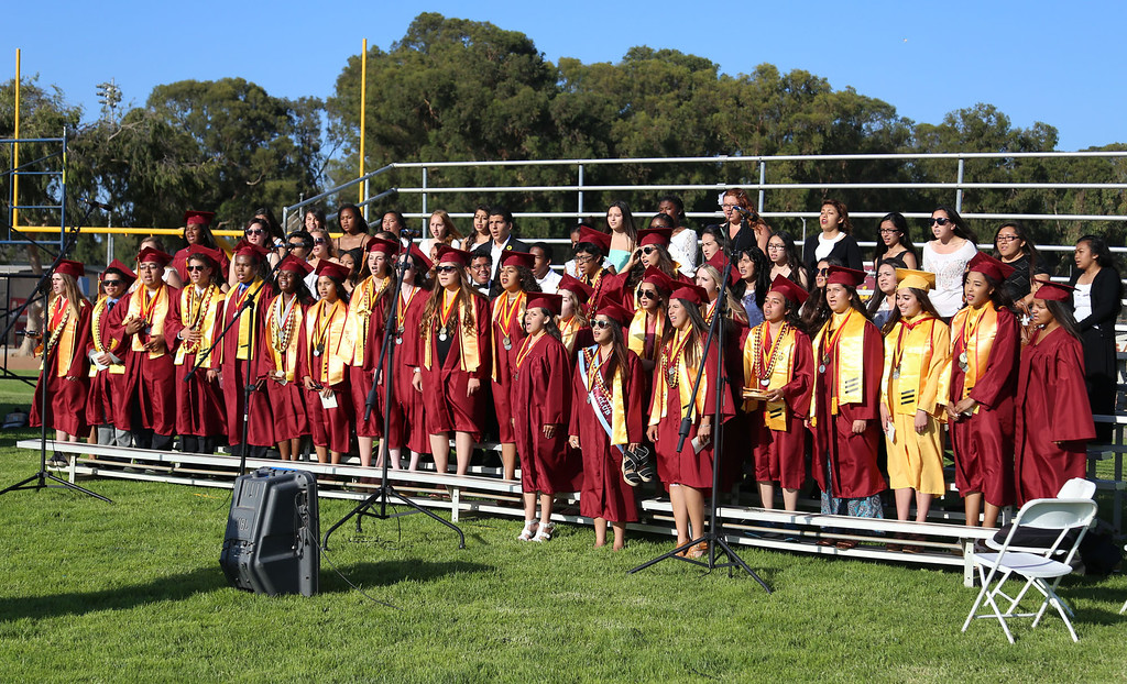 ". The choir performs ""Seasons of Love\"" during Thursday evening\'s commencement at Stephens Field at Woodrow Wilson Classical High School in Long Beach, CA Thursday, June 12, 2014. (Photo by Mark Dustin for the Press-Telegram)"