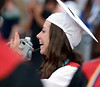 Bob Raines--Montgomery Media<br /> A new graduate waves to some of her friends as the Class of 2015 leaves the stadium after the William Tennent High School graduation June 17. 2015.