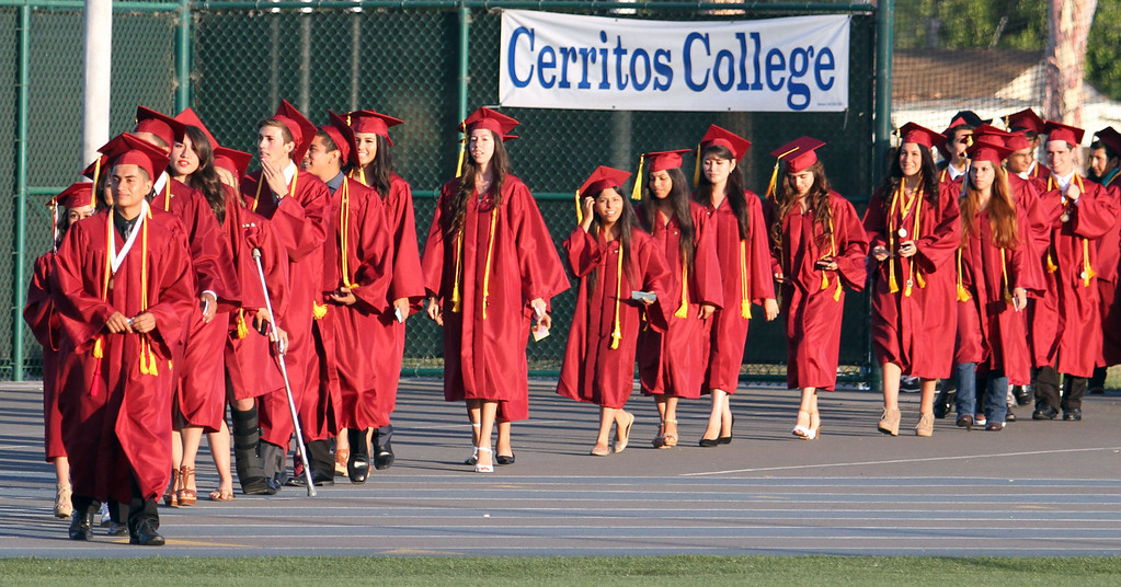 . Graduate candidates walk onto the field at the start of the Diploma Presentation during Downey High School\'s 111th Commencement Ceremony Wednesday evening in Falcon Stadium at Cerritos College in Norwalk, CA Wednesday, June 18, 2014. (Photo by Mark Dustin for the Press-Telegram)