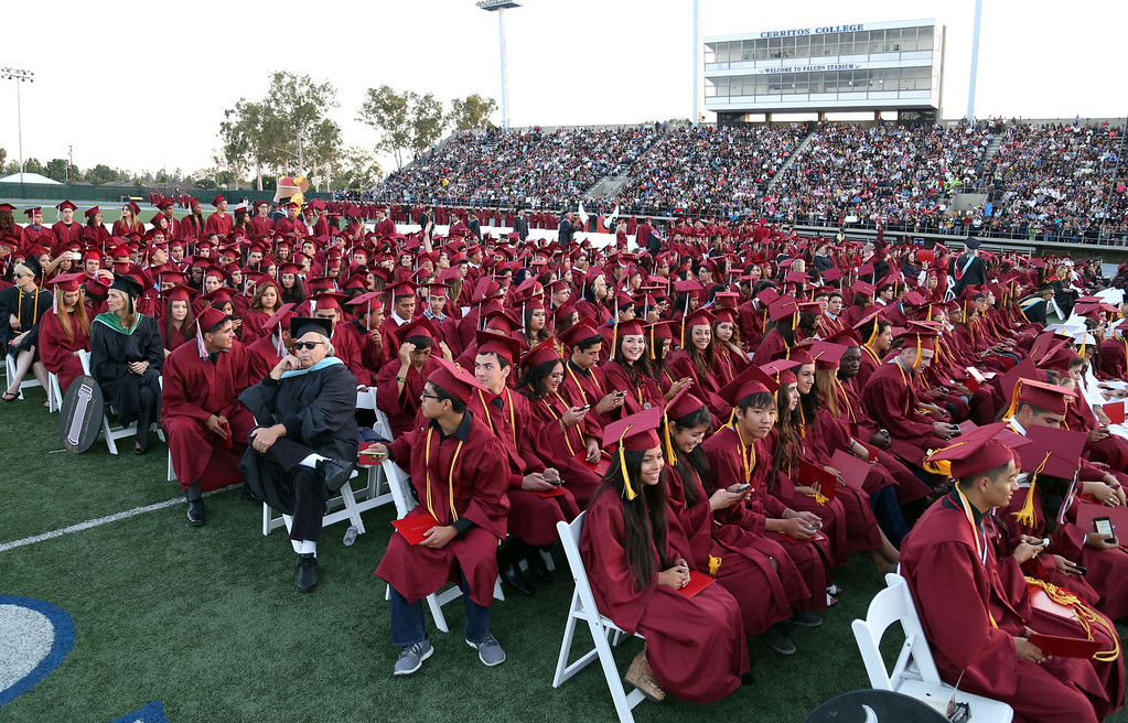 . Graduate candidates sit in their seats during Downey High School\'s 111th Commencement Ceremony Wednesday evening in Falcon Stadium at Cerritos College in Norwalk, CA Wednesday, June 18, 2014. (Photo by Mark Dustin for the Press-Telegram)