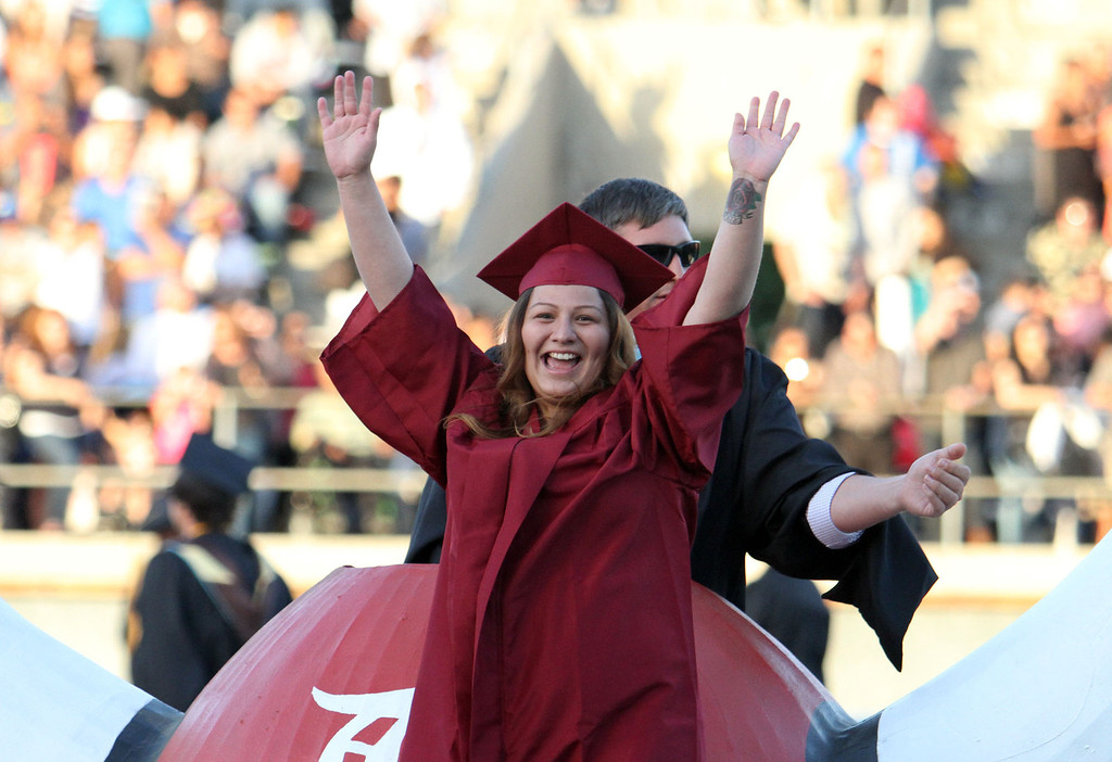 . Vanessa Alcon waves to the crowd after being announced during the Diploma Presentation during Downey High School\'s 111th Commencement Ceremony Wednesday evening in Falcon Stadium at Cerritos College in Norwalk, CA Wednesday, June 18, 2014. (Photo by Mark Dustin for the Press-Telegram)