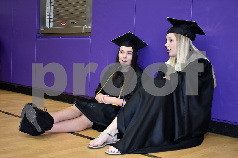 -Messenger photo by Chad Thompson<br /> <br /> Allyson Plain, 18, left, and Allison Purcell, 18, sit together at Robert Blue Middle School Sunday afternoon prior to graduating from Eagle Grove Community High School.
