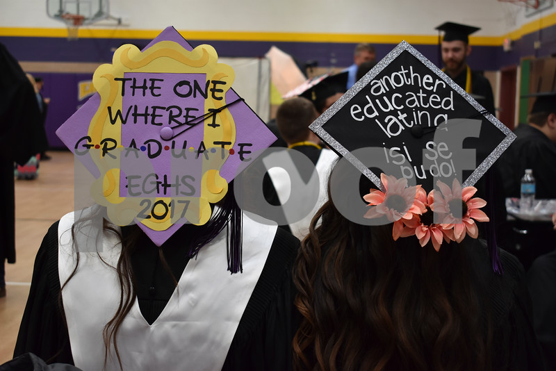 -Messenger photo by Chad Thompson<br /> <br /> Megan Larsen, 18, left, and April Garcia, 18, display their graduation caps prior to graduating Eagle Grove Community High School at Robert Blue Middle School Sundaya afternoon.