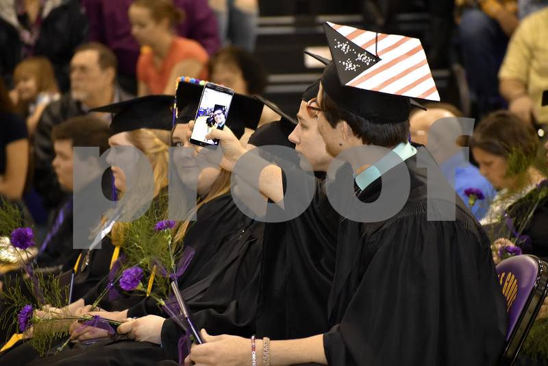 -Messenger photo by Chad Thompson<br /> <br /> Austin Burgwin, 18, front, gets in a selfie during the Eagle Grove Community High School commencement Sunday afternoon.