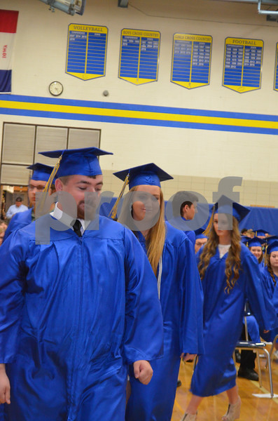 Messenger photo by Bill Shea<br />  Austin Anderson, left, and Brooke Anderson, middle, lead the way as the members of the Humboldt High School Class of 2017 head to the stage to receive their diplomas.