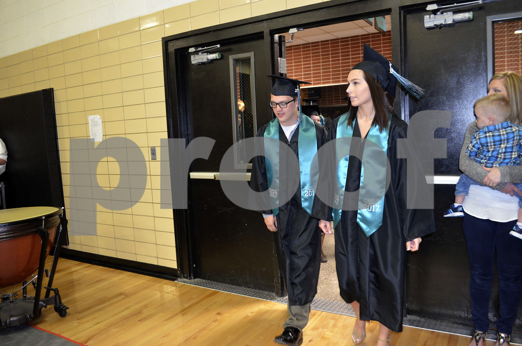 -Messenger photo by Kriss Nelson<br /> <br /> Kaelan Lunbderg, left and Morgan Nott walk in to graduation at Southeast Valley High School on Sunday afternoon.
