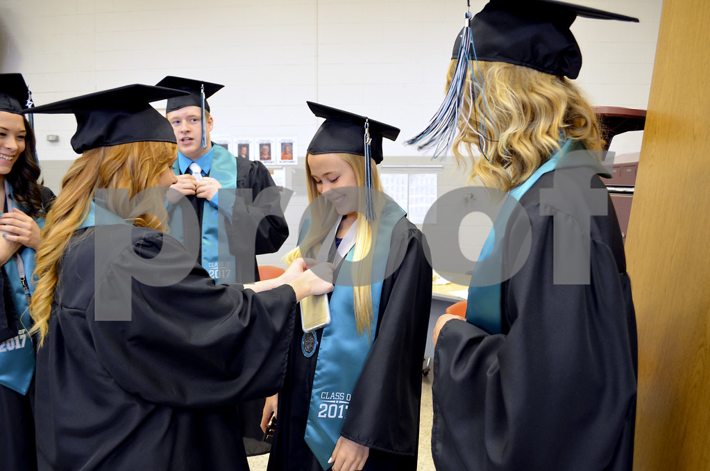 - Messenger photo by Kriss Nelson<br /> <br /> Makayla Anderson helps Ryann Steburg get ready for graduation as Kenley Clough (right) and Keanna Taylor and Clayton Kiefer look on.