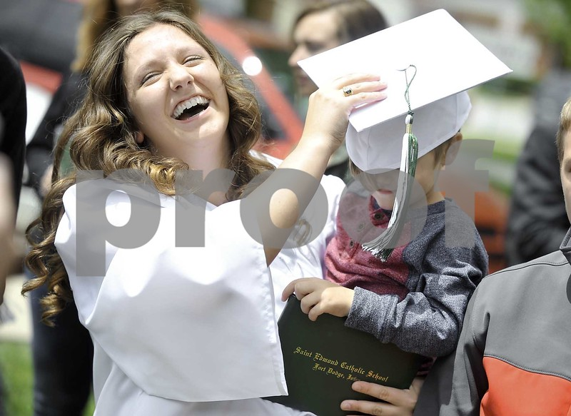 -Messenger photo by Hans Madsen<br /> <br /> Freshly graduated St. Edmond Catholic School alumni Jerrica Fitzgerald laughs after trying without much success to get her little brother, Zayden Nelson, 4, to wear her cap after commencement.