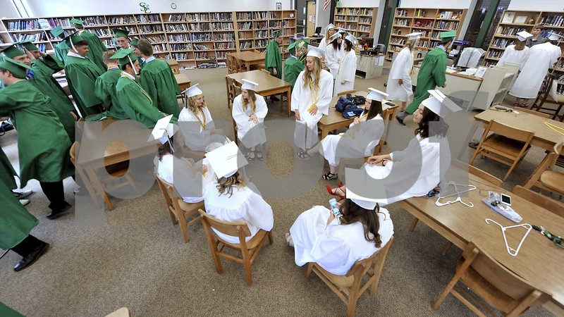 -Messenger photo by Hans Madsen<br /> <br /> A group of soon to be graduates enjoy a few moments of conversation Sunday afternoon as they wait in the media center at St. Edmond Catholic School for commencement exercises to get started.
