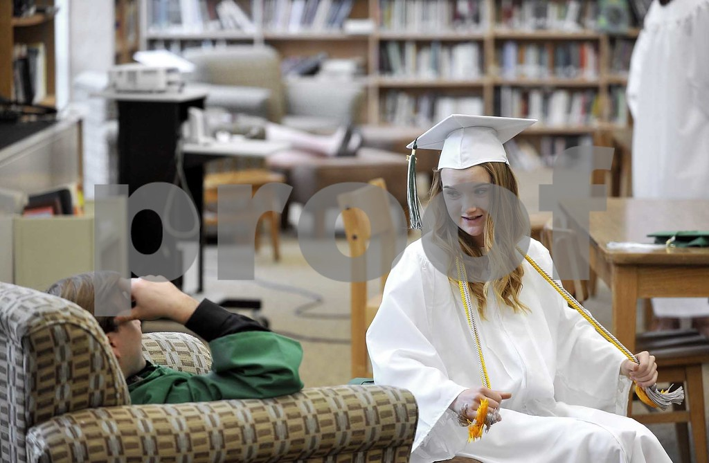 -Messenger photo by Hans Madsen<br /> <br /> Soon to be graduates Logan Fear, at left, along with Madi Tarbox, enjoy a few minutes of conversation Sunday afternoon in the St. Edmond Catholic School media center while waiting for commencement to start.