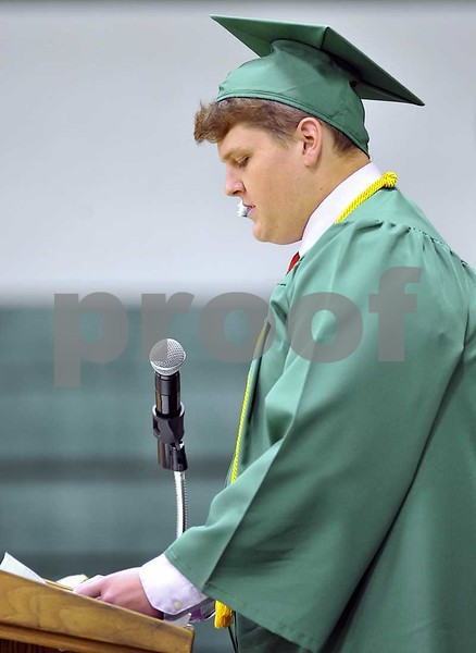 -Messenger photo by Hans Madsen<br /> <br /> St. Edmond Catholic High School class speaker Charles Doyle delivers his remarks Sunday afternoon during the 62nd annual Commencement.