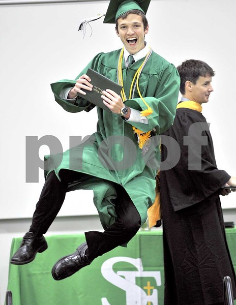 -Messenger photo by Hans Madsen<br /> <br /> Nicholas Simpson jumps for joy Sunday afternoon after getting his diploma during the 62nd annual commencement at St. Edmond Catholic School. Ben Crimmins, chair of the St. Edmond School Board, is at right getting ready to hand out another diploma.